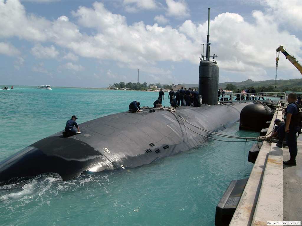 USS Cheyenne (SSN-773) tied up to the dock in the beautiful turquoise waters of Saipan, March 2005.